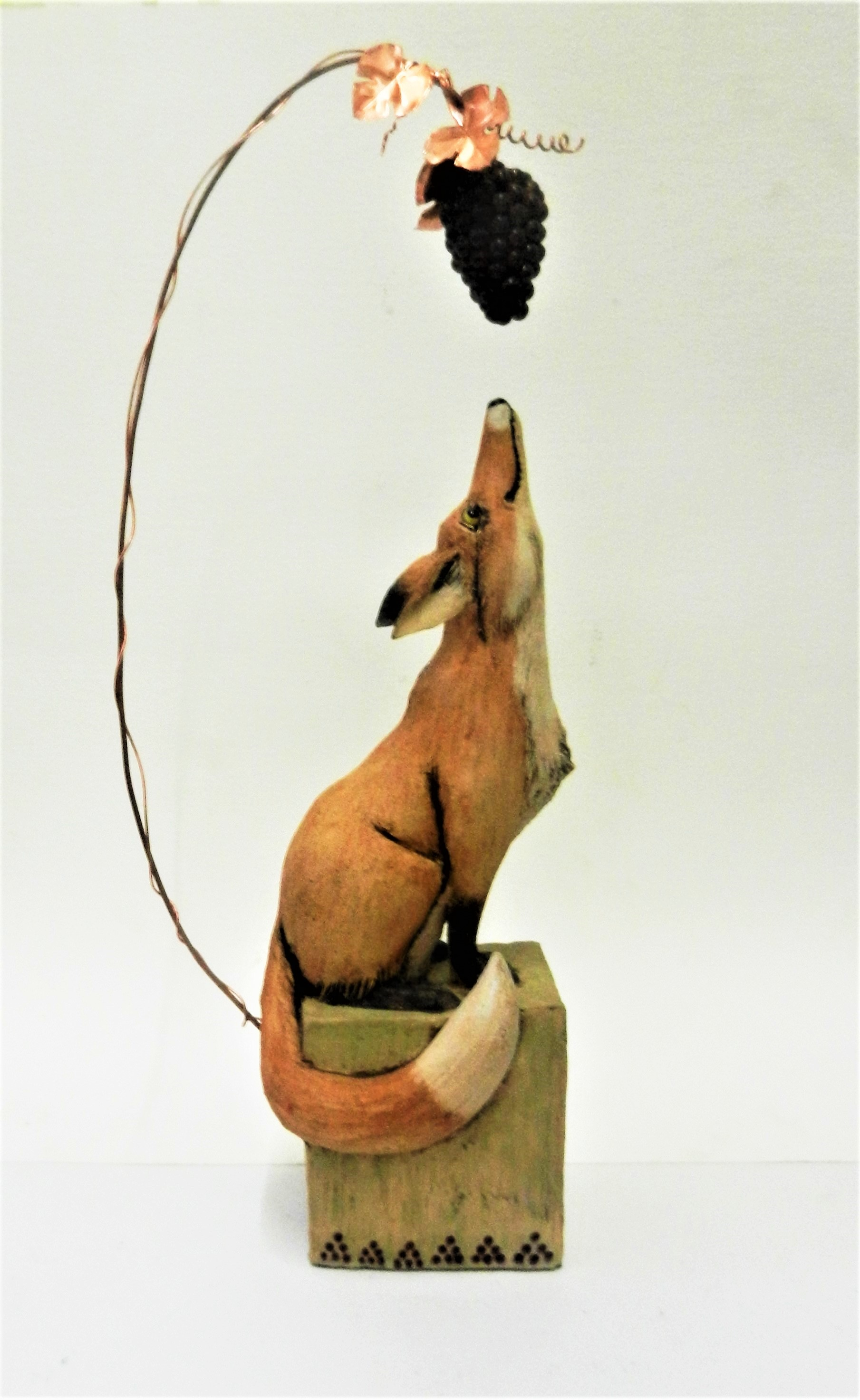 Fox and grapes sculpture