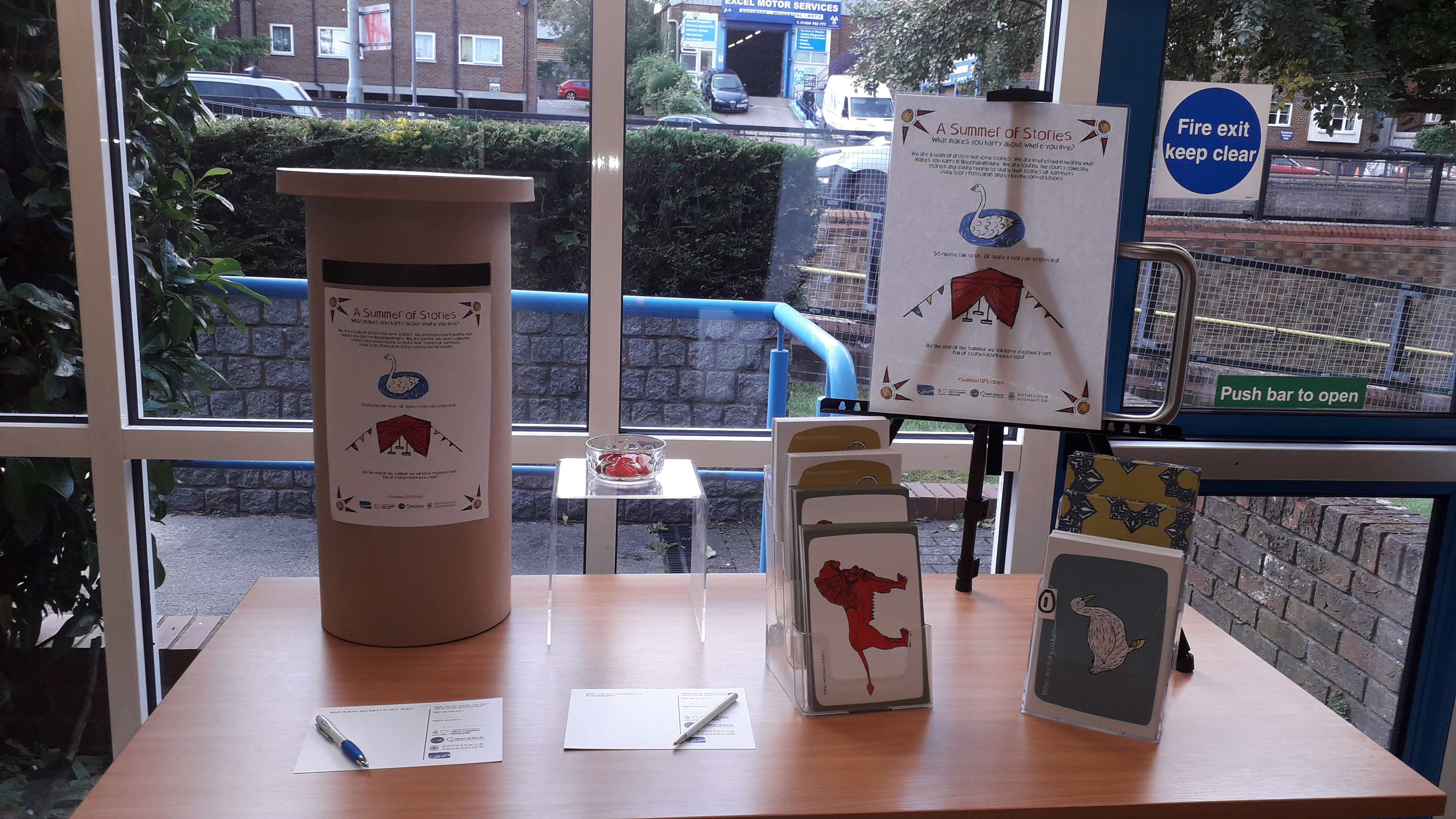 Image of story postcards and cardboard post box display