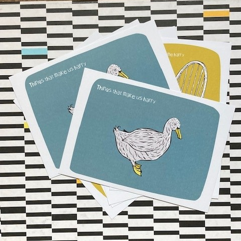 Postcards with a duck and a chair